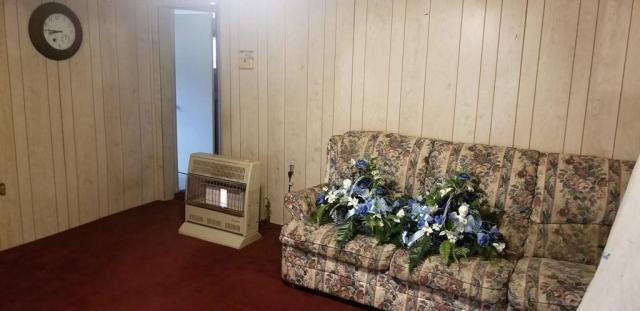 Living room featured at 9193 Rockcastle Rd, Inez, KY 41224