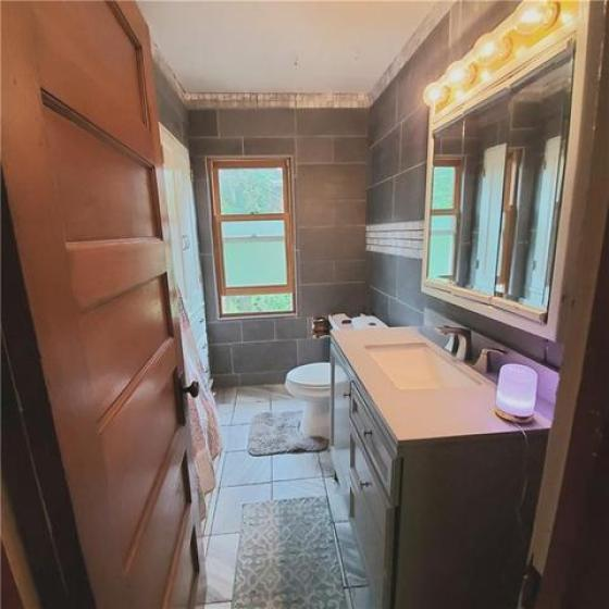 Bathroom featured at 6137 Wright St, Wolcott, NY 14590