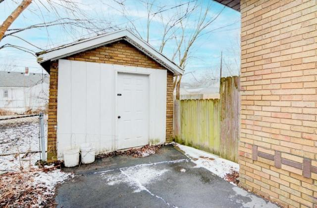 Garage featured at 2111 E Wood St, Decatur, IL 62521