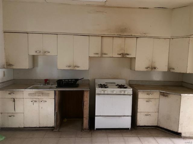 Kitchen featured at 718 S High St, Belleville, IL 62220