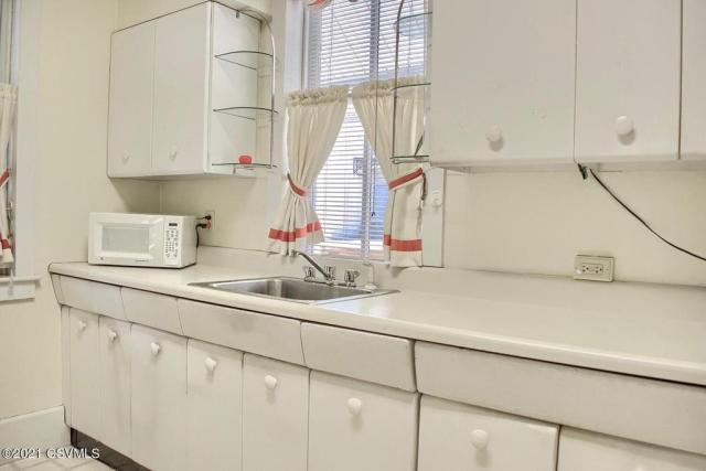 Laundry room featured at 164 Main St, Paxinos, PA 17860