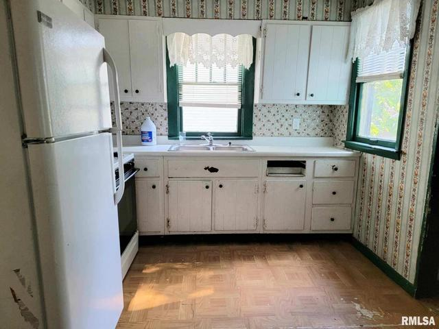 Kitchen featured at 1217 N Bourland Ave, Peoria, IL 61606