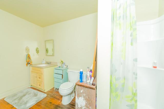 Bathroom featured at 127 W 9th St, Coffeyville, KS 67337