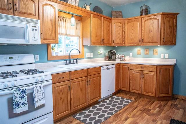 Kitchen featured at 401 SW 3rd Ave, Tripoli, IA 50676