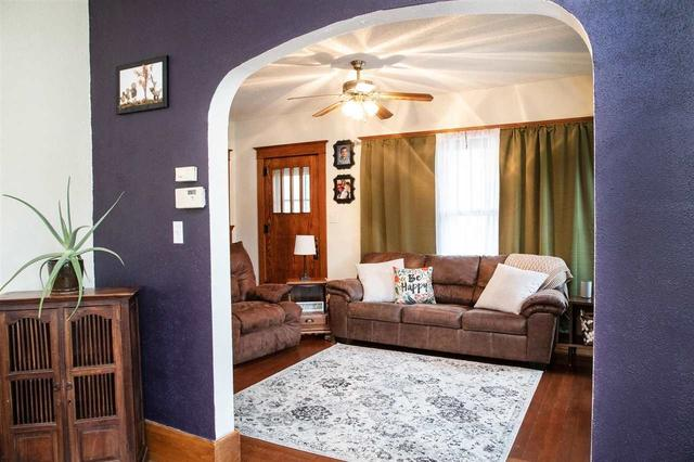 Living room featured at 401 SW 3rd Ave, Tripoli, IA 50676