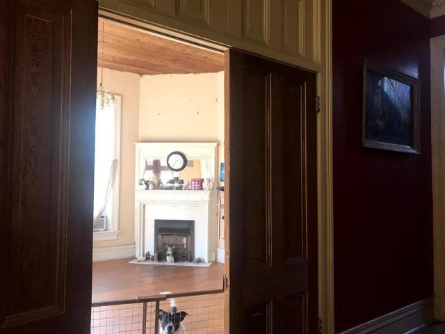 Living room featured at 419 E Broadway St, Yazoo City, MS 39194