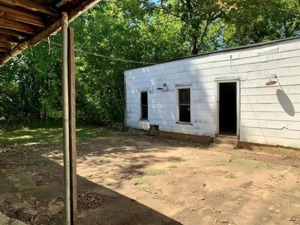 Porch yard featured at 1008 and 1100 Gibson St, Ozark, AR 72949