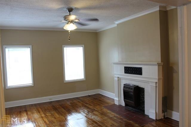 Living room featured at 400 Fourth St, Summerville, GA 30747