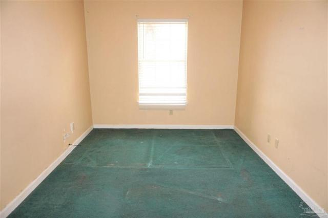 Bedroom featured at 409 N B St, Pensacola, FL 32501