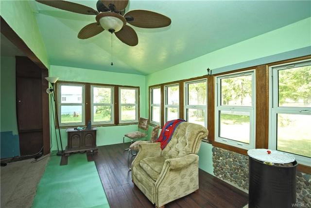 Living room featured at 239 Dawn Ave, Angola, NY 14006