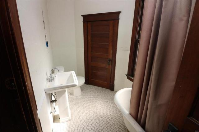 Bathroom featured at 222 N 1st St, Pacific, MO 63069