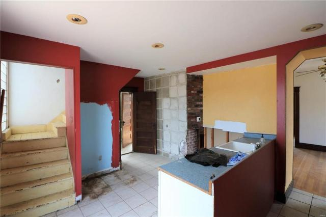 Laundry room featured at 222 N 1st St, Pacific, MO 63069
