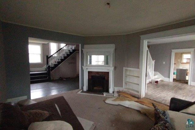 Living room featured at 106 S Poplar Ln, Hinckley, MN 55037