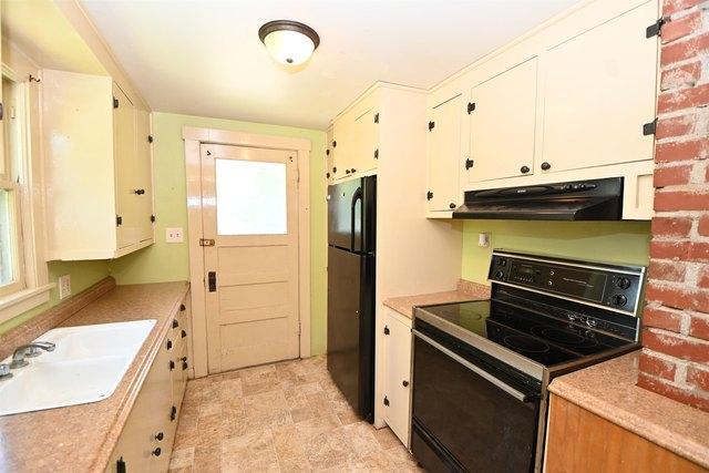 Kitchen featured at 100 Iowa Ave, Holton, KS 66436