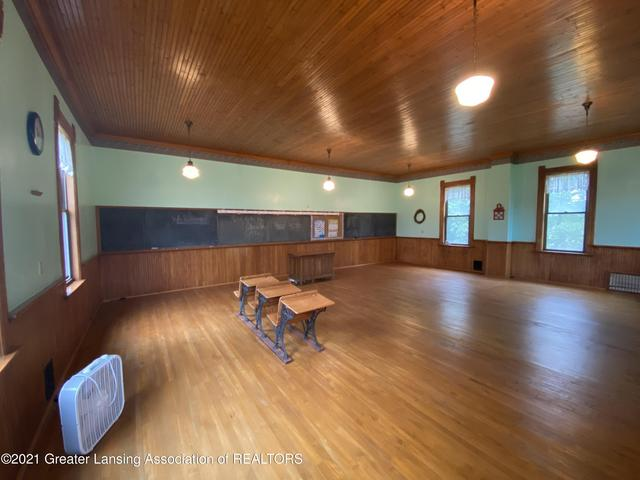 Living room featured at 6510 N Hartel Rd, Potterville, MI 48876