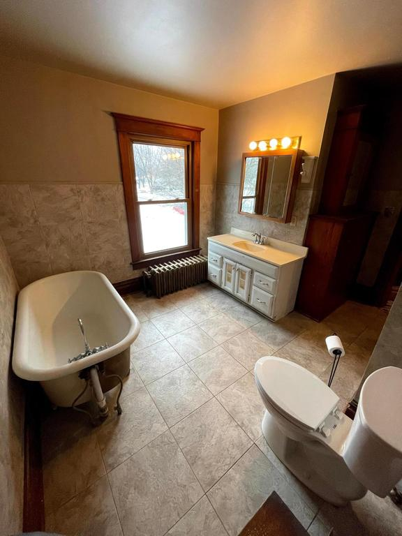 Bathroom featured at 387 4th St, Tracy, MN 56175