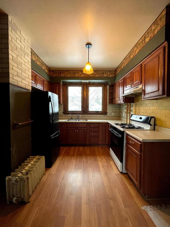 Kitchen featured at 387 4th St, Tracy, MN 56175
