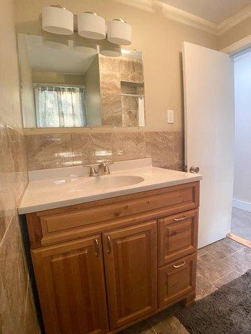 Bathroom featured at 509 W Church St, Logan, KS 67646