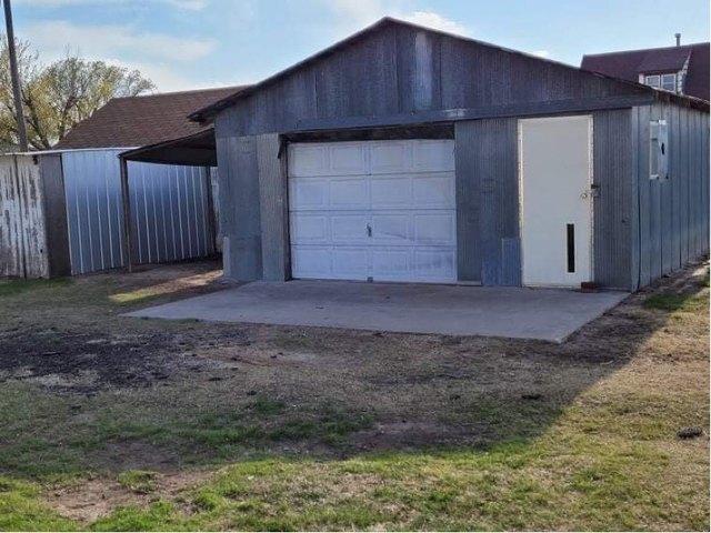 Garage featured at 509 W Church St, Logan, KS 67646