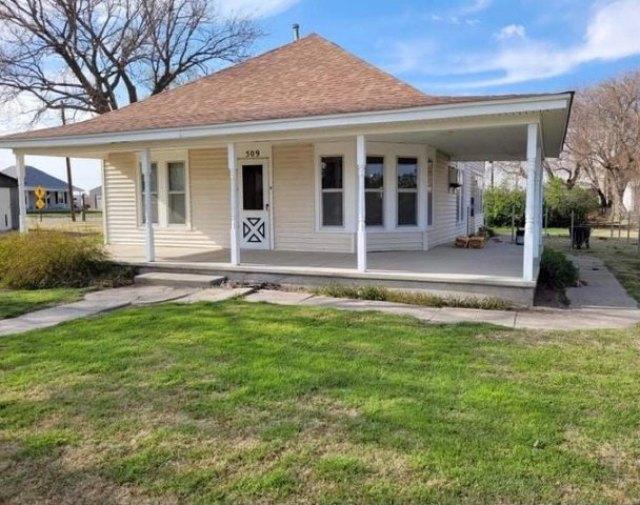 Porch featured at 509 W Church St, Logan, KS 67646