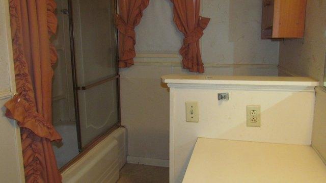 Bathroom featured at 904 S Tennessee St, Crossett, AR 71635