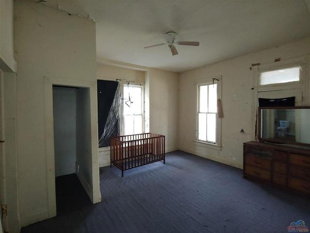 Bedroom featured at 605 S Washington St, Clinton, MO 64735