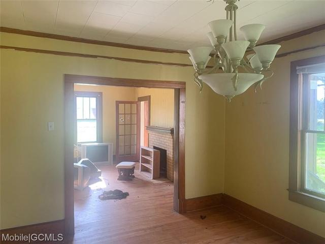Dining room featured at 19230 Rowe St, Citronelle, AL 36522