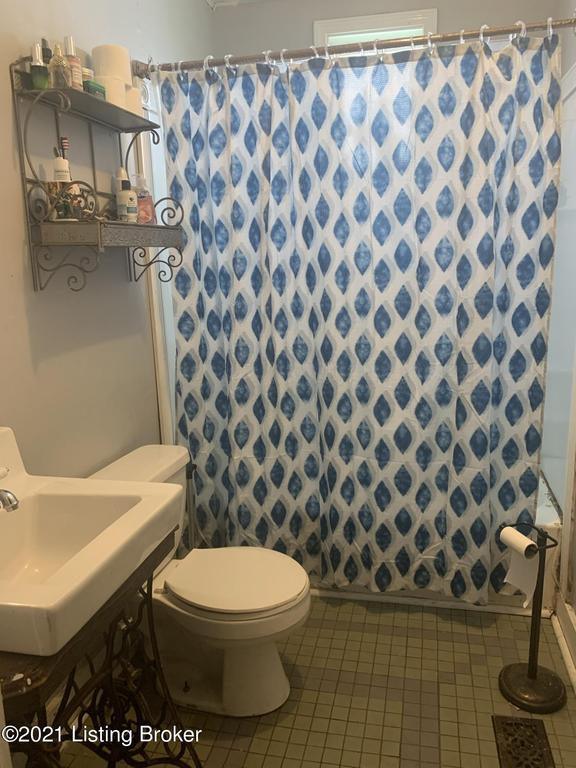 Bathroom featured at 1849 Bank St, Louisville, KY 40203