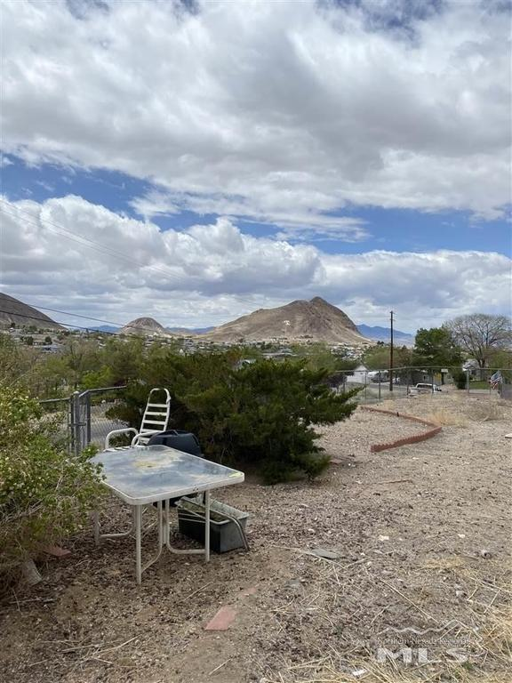 Road view featured at 19 NW Crescent Dr, Tonopah, NV 89049
