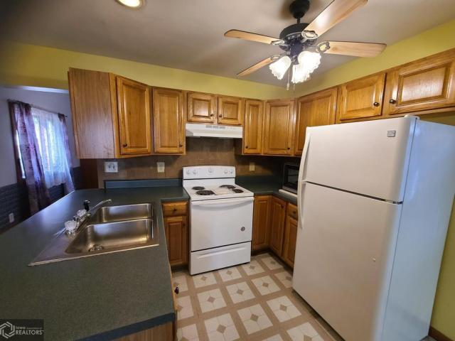 Kitchen featured at 227 N Main St, Conrad, IA 50621