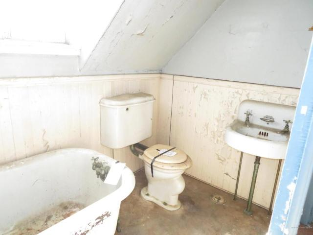 Bathroom featured at 18 Wiley St, Bangor, ME 04401