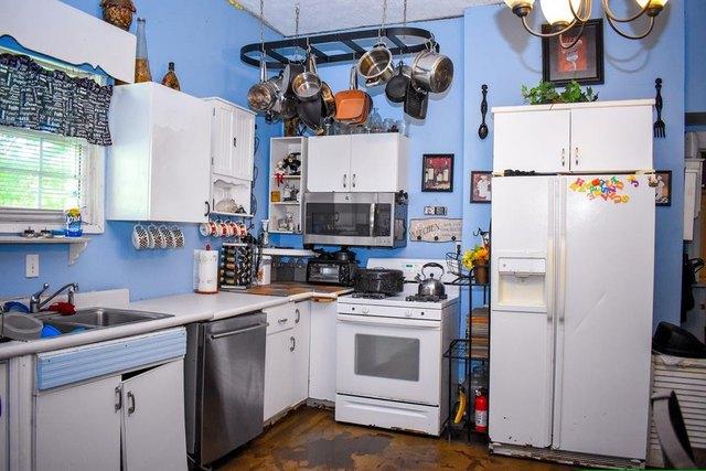 Kitchen featured at 223 Edisto St, Johnston, SC 29832