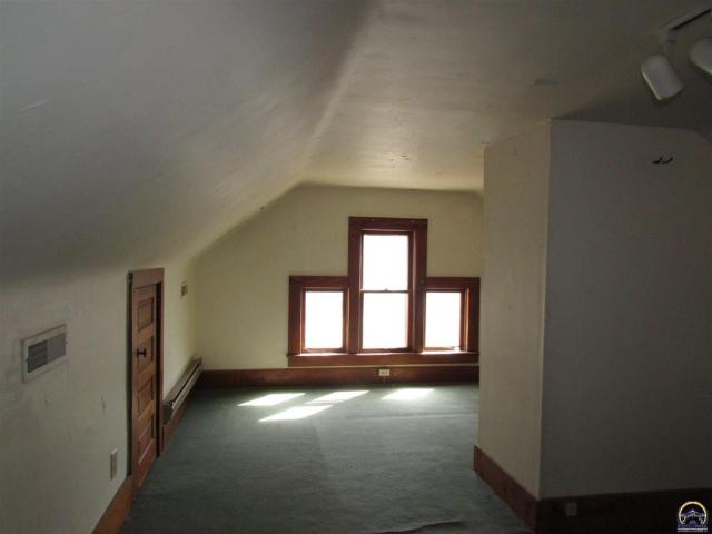 Property featured at 815 SW Lincoln St, Topeka, KS 66606