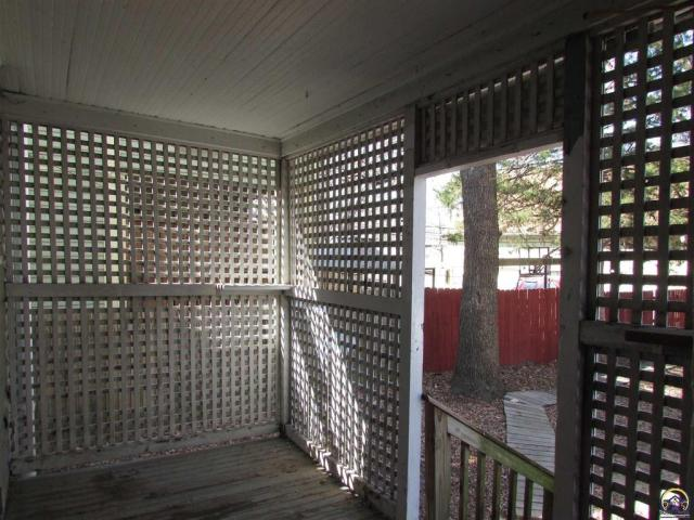 Porch featured at 815 SW Lincoln St, Topeka, KS 66606