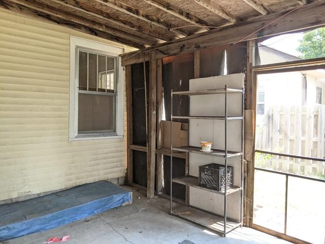 Porch featured at 813 W 6th St, Coffeyville, KS 67337