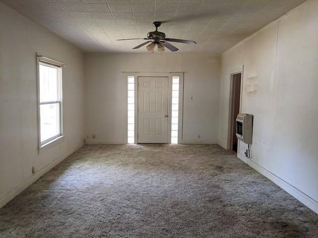 Bedroom featured at 813 W 6th St, Coffeyville, KS 67337