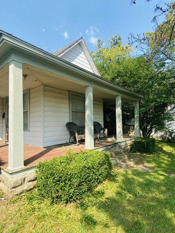 Porch yard featured at 401 E Spring St, El Dorado Springs, MO 64744