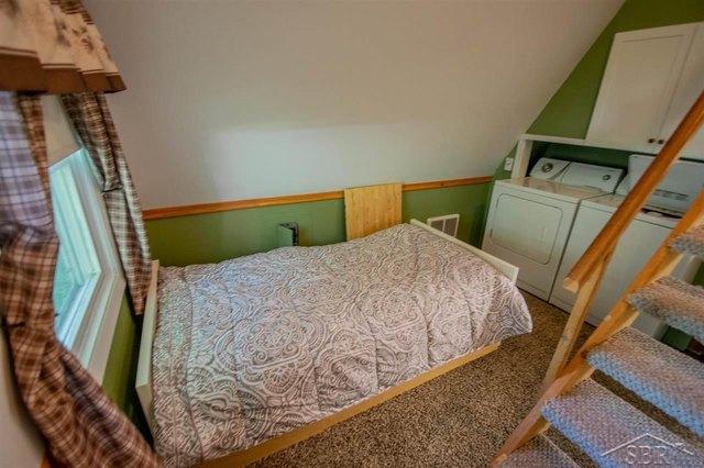 Bedroom featured at 2647 S Whitney Beach Rd, Beaverton, MI 48612