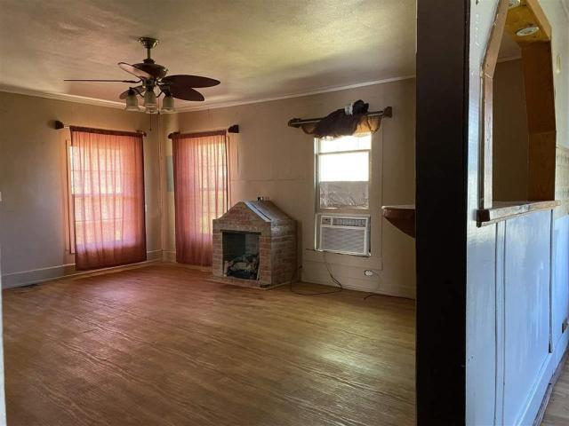 Living room featured at 111 S High St, Henderson, TX 75654