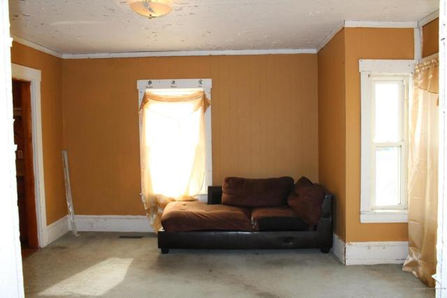 Living room featured at 74 Riverside St, Milo, ME 04463