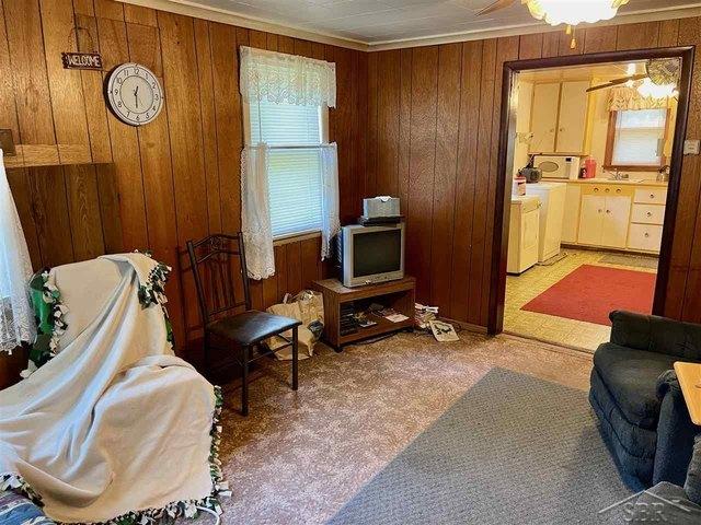 Living room featured at 5339 Beals Dr, Prescott, MI 48756