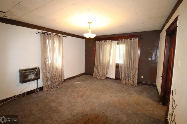 Bedroom featured at 300 S Carthage St, Exira, IA 50076