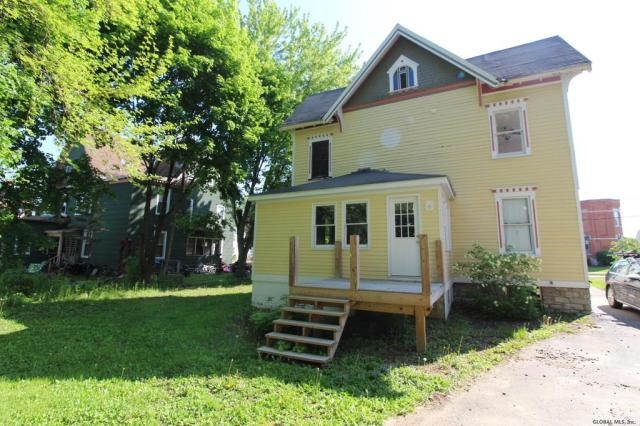 Porch yard featured at 21 Willett St, Fort Plain, NY 13339