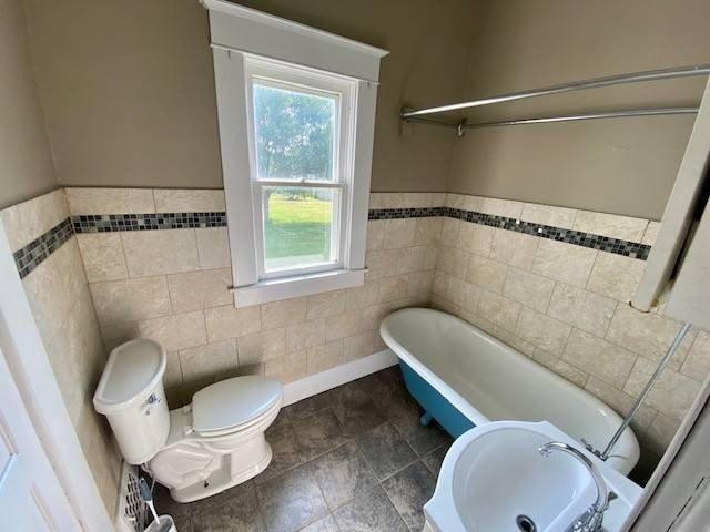 Bathroom featured at 807 Walnut St, Tarkio, MO 64491