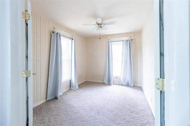 Bedroom featured at 709 S Washington St, Du Quoin, IL 62832