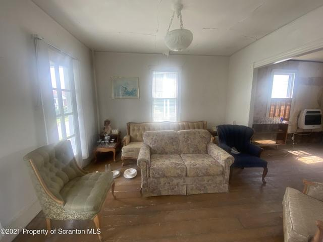 Living room featured at 412 Delaware Ave, Olyphant, PA 18447