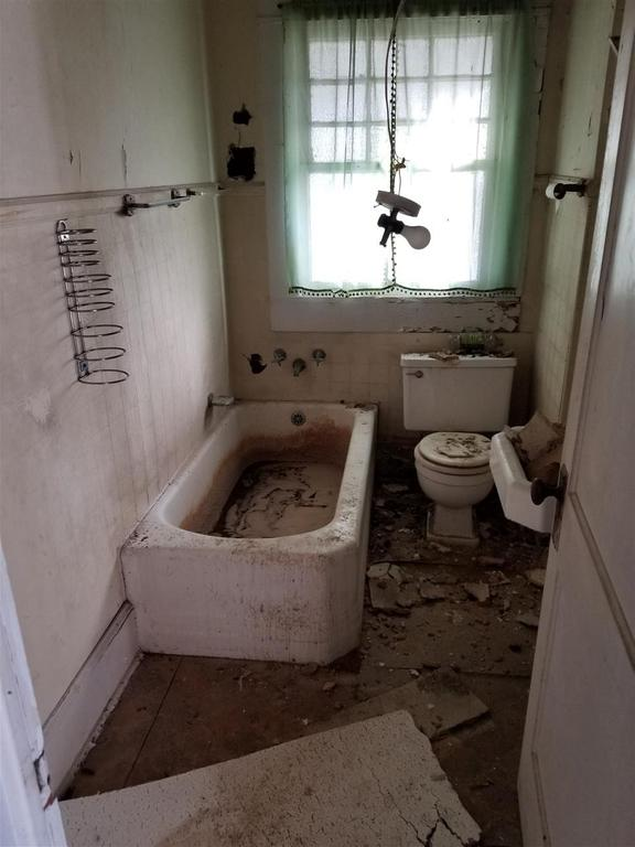 Bathroom featured at 606 N Broad St, Clinton, SC 29325