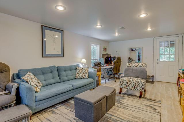 Living room featured at 452 N Spring St, Crestview, FL 32536