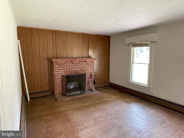 Living room featured at 3349 Sackertown Rd, Crisfield, MD 21817