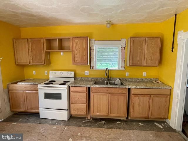 Kitchen featured at 3349 Sackertown Rd, Crisfield, MD 21817